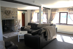 The downstairs lounge area in Willowhurst, Care in Mind's service in Preston